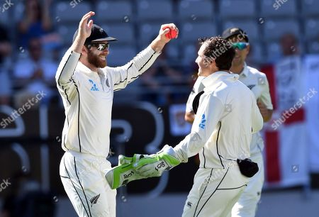 Kane Wlliamson, BJ Watling. New Zealand's Kane Williamson, left, celebrates with BJ Watling after taking the catch to dismiss England's Jonathan Bairstow for 26 during their first cricket test in Auckland, New Zealand