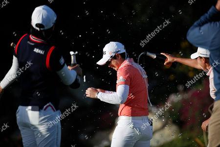 Eun-Hee Ji, Jeong Eun Lee, In-Kyung Kim. South Korea's Jeong Eun Lee, left, and In-Kyung Kim spray champagne on Eun-Hee Ji, center, after Ji won the Kia Classic LPGA golf tournament, in Carlsbad, Calif