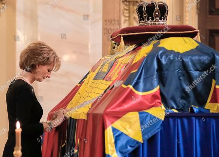 Princess Margaret of Hohenzollern, daughter of former Romanian King Michael, stands by her father's coffin, at the former royal palace, in Bucharest, Romania, . Thousands waited in line to pay their respects to Former King Michael, who ruled Romania during WWII, and died on Dec. 5, 2017, aged 96, in Switzerland