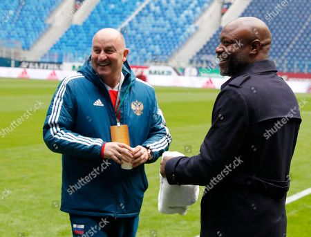 Russia's head coach Stanislav Cherchesov (L) and former France's defender William Gallas pose before Russia's soccer team training session at Saint-Petersburg stadium in St. Petersburg, Russia, 26 March 2018. The 2006 FIFA World Cup runner-up and former France, Chelsea, Arsenal and Tottenham Hotspur defender William Gallas arrived to Saint Petersburg to support his national soccer team. Russia will face France in their International Friendly soccer match on 27 March.