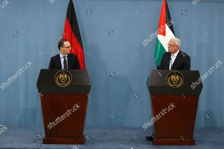 German Foreign Minister Heiko Maas, left, and his Palestinian counterpart Riad al-Malki attend a press conference in the West Bank city of Ramallah