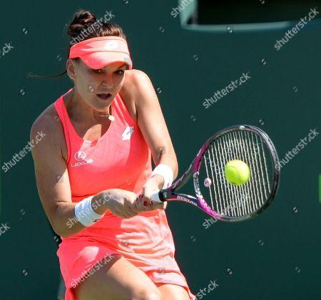 Agnieszka Radwanska (POL) defeats Simone Halep (ROU) by 3-6, 6-2, 6-3, at the Miami Open being played at Crandon Park Tennis Center in Miami, Key Biscayne, Florida.©Karla Kinne/Tennisclix/CSM
