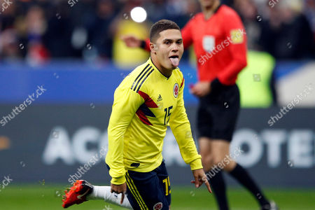 Colombia's Juan Fernando Quintero celebrates his side's 3rd goal on a penalty kick during a friendly soccer match between France and Colombia, at the Stade de France stadium in Saint-Denis, outside Paris, France