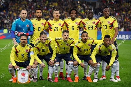 The Columbian national soccer team poses before a friendly soccer match against France at the Stade de France stadium in Saint-Denis, outside Paris, France, . First row from left to right : Radamel Falcao, James Rodriguez, Santiago Arias, Luis Fernando Muriel and Frank Fabra. Second row from left to right : David Ospina, Abel Aguilar, Mateus Uribe, Carlos Alberto Sanchez, Davinson Sanchez and Yerry Mina