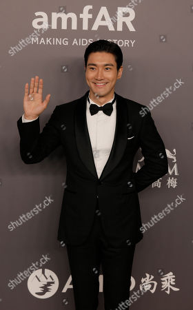 Stock Photo of Choi Siwon, a member of South Korean pop group Super Junior poses on the red carpet during the fundraising gala organized by amfAR (The Foundation for AIDS Research) in Hong Kong