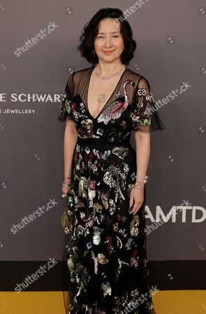 Pansy Ho, Managing Director of Shun Tak Holdings poses on the red carpet during the fundraising gala organized by amfAR (The Foundation for AIDS Research) in Hong Kong