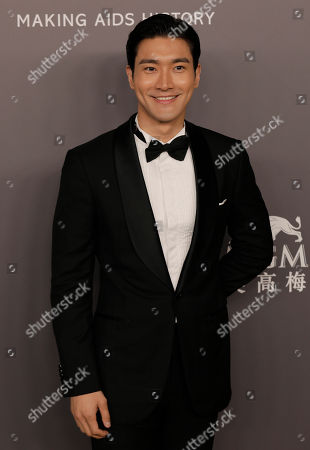 Choi Siwon, a member of South Korean pop group Super Junior poses on the red carpet during the fundraising gala organized by amfAR (The Foundation for AIDS Research) in Hong Kong
