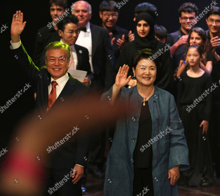 Moon Jae-in, Kim Jung-soo. South Korean President Moon Jae-in, left, waves to a crowd with his wife Kim Jung-sook in Abu Dhabi, United Arab Emirates, . On Monday, Jae-in visited a new nuclear power plant his country is helping build in the United Arab Emirates and watched a cultural performance later that night in Abu Dhabi, the UAE's capital