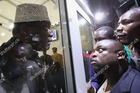 Kenyan lawyer and opposition figure Miguna Miguna (L) talks to his supporters (R) from a closed door after he was detained at immigration upon his arrival at the Jomo Kenyatta International Airport in Nairobi, Kenya, 26 March 2018. Miguna who was traveling on his Canadian passport, was blocked from entering the country and deported back to Dubai after he refused to apply for a Kenyan visa upon his arrival. Paramilitary police were deployed at the airport to disperse opposition supporters and journalists using force that left some journalists injured. The government on 07 February deported Miguna to Canada, disobeying five court orders to release him or produce him in court after arresting him for taking part in a mock ?swearing-in? ceremony of the opposition leader Raila Odinga, who since has agreed to work with his rival President Uhuru Kenyatta. The High Court on 15 February ruled Miguna?s deportation illegal.