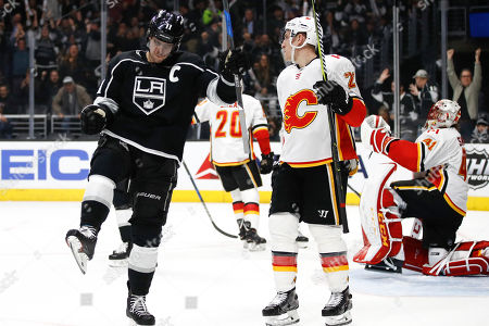 Anze Kopitar, Michael Stone. Los Angeles Kings' Anze Kopitar, left, of Slovenia, celebrates his goal as he skates past Calgary Flames' Michael Stone during the second period of an NHL hockey game, in Los Angeles