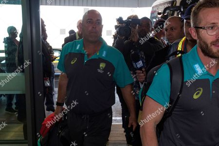 Australian cricket coach Darren Lehmann arrives with his team at the Cape Town International airport as they depart to Johannesburg for the final five day cricket test match, in Cape Town, South Africa, . Australia skipper Steve Smith has been suspended by the International Cricket Council for the match for his part in a ball tampering scandal during the third test. Smith admitted some senior players were aware of the tampering attempt