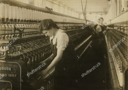 Bertha Bonneau, 15 years old, Doffer on Jack Speeder in Card Room, King Philip Mills, Fall River, Massachusetts, USA, Lewis Hine for National Child Labor Committee, June 1916