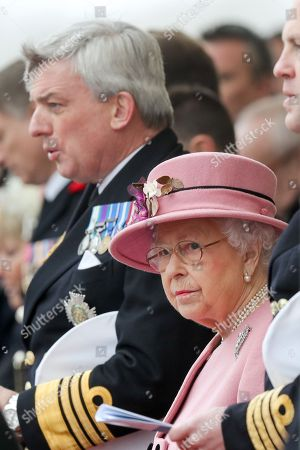 Queen Elizabeth II with First Sea Lord Admiral Sir Philip Jones (left) at the decommissioning ceremony for HMS Ocean at HMNB Devonport in Plymouth