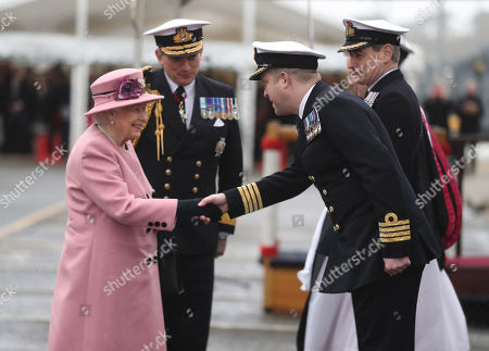 Queen Elizabeth II with First Sea Lord Admiral Sir Philip Jones (2nd left) meet Captain of HMS Ocean Captain Rob Pedre (2nd right) at the decommissioning ceremony for HMS Ocean at HMNB Devonport in Plymouth.