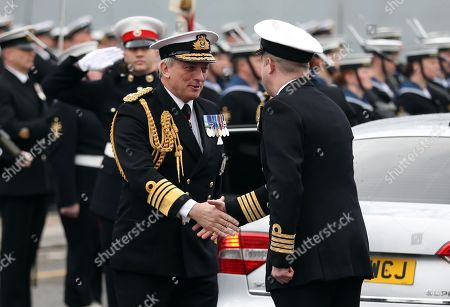 First Sea Lord Admiral Sir Philip Jones (left) greets Captain of HMS Ocean Captain Rob Pedre (right) at the decommissioning ceremony for HMS Ocean at HMNB Devonport in Plymouth