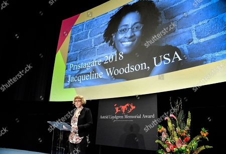 Chairman of the Astrid Lindgren Memorial Award jury announces this year's laureate, Amercan writer Jacqueline Woodson (seen on the screen in the backgrouond), during a press conference in Stockholm, Sweden, 27 March 2018. The ALMA award is the world's largets Children's literature award. Woodson will receive the price of five million Swedish kronor (Euro 490,000 or USD 600,000).
