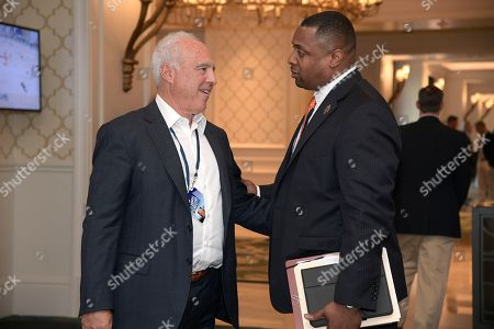Jeffrey Lurie, Troy Vincent. Philadelphia Eagles owner Jeffrey Lurie, left, chats with Troy Vincent, NFL executive vice president of football operations, during the NFL owners meetings, in Orlando, Fla