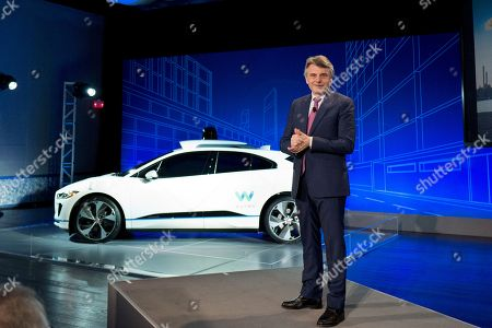 Stock Photo of John Krafcik, Ralf Speth. Ralf Speth, the CEO of Jaguar, introduces the Jaguar I-Pace vehicle, in New York. Self-driving car pioneer Waymo will buy up to 20,000 of the electric vehicles from Jaguar Land Rover to help realize its vision for a robotic ride-hailing service. The commitment announced Tuesday marks another step in Waymo's evolution from a secret project started in Google nine years ago to a spin-off that's gearing up for an audacious attempt to reshape the transportation business