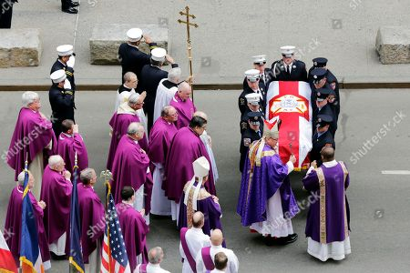 Archbishop Timothy Dolan, second from right, presides over the casket of New York City firefighter Michael Davidson as it leaves St. Patrick's Cathedral, in New York, . Davidson died early Friday battling a fierce blaze on a movie set after getting separated from his fellow firefighters in the thick smoke