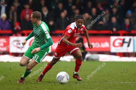 Crawley's Lewis Young takes on Matthew Taylor of Swindon during the Sky Bet League 2 match between Crawley Town and Swindon Town at the Checkatrade Stadium in Crawley. 02 Apr 2018