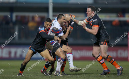 Wakefield Trinity's Bill Tupou is caught by Jake Webster of Castleford and Ben Roberts of Castleford