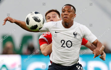 Vladimir Granat (L) of Russia in action against Anthony Martial (R) of France during the international friendly soccer match between Russia and France at the Zenit Arena in St. Petersburg, Russia, 27 March 2018.