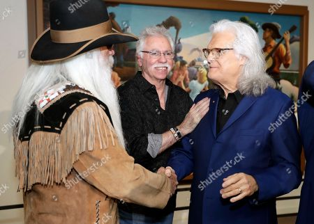 Stock Image of Ricky Skaggs, William Lee Golden, Joe Bonasll. Ricky Skaggs, right, is congratulated by William Lee Golden, left, and Joe Bonsall, both of the Oak Ridge Boys, after it was announced that Skaggs will be inducted into the Country Music Hall of Fame, in Nashville, Tenn. The late Johnny Gimble and the late Dottie West will also be inducted
