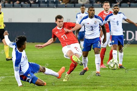 Switzerland's forward Fabian Frei, center, scores to 5:0 against Panama's Luis Ovalle during an international friendly soccer match between Switzerland and Panama at the Swissporarena, in Lucerne, Switzerland, 27 March 2018.