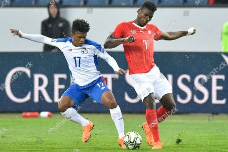 Switzerland's forward Breel Embolo, right, fights for the ball against Panama's Luis Ovalle during an international friendly soccer match between Switzerland and Panama at the Swissporarena, in Lucerne, Switzerland, 27 March 2018.