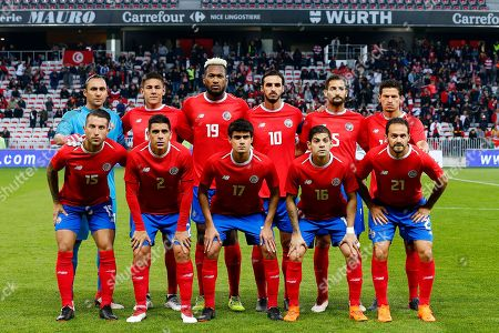 The Costa Rica team pose for a pre-match group photograph.