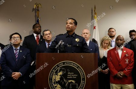 Sacramento Police Chief Daniel Hahn, center, flanked civic and community leaders announced that he has asked Attorney General Xavier Becerra's office to be part of an independent investigation of the shooting death of Stephon Clark by two Sacramento Police officers, in Sacramento, Calif. Clark, who was unarmed, was shot and killed a week ago by officers responding to a call about a person smashing car windows