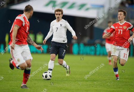 Antoine Griezmann, Vladimir Granat, Alexander Golovin. France's Antoine Griezmann, centre, faces Russia's Vladimir Granat, left, and Alexander Golovin during the international friendly soccer match between Russia and France at the Saint Petersburg stadium in St.Petersburg, Russia