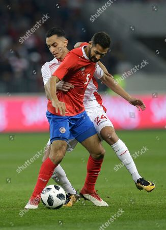 Costa Rica's Celso Borges, foreground, and Tunisia's El Khaoui Saif Eddine challenge the ball during a friendly soccer match between Tunisia and Costa Rica at the Allianz Riviera stadium in Nice, southern France