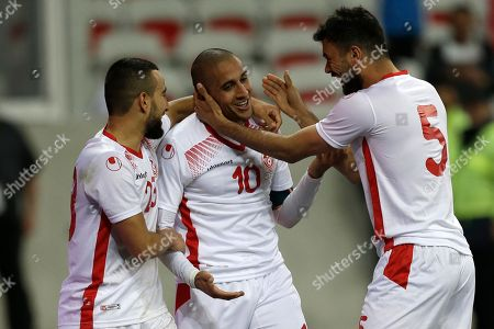 Tunisia's Ali Maaloul, center, is congatulated by Tunisia's Oussama Haddadi, right, and Tunisia's Naim Sliti after scoring his side opening goal during a friendly soccer match between Tunisia and Costa Rica at the Allianz Riviera stadium in Nice, southern France