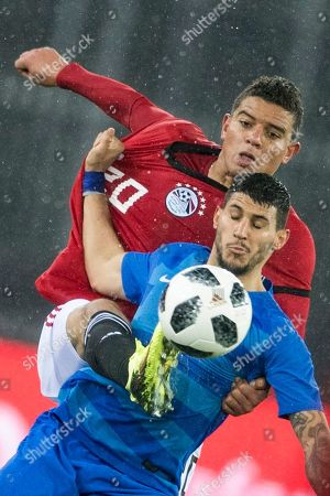 Greece's Nikolaos Karelis, right, fight for the ball against Egypt's Saad Samir, left, during the soccer friendly game Egypt against Greece at the Letzigrund stadium in Zurich, Switzerland, on Tuesday, March 27, 2018.