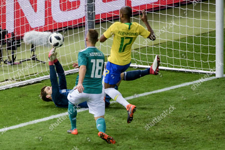 0870a9a3a556 Germany s goalkeeper Kevin Trapp (L) concedes the 0-1 goal during an  international