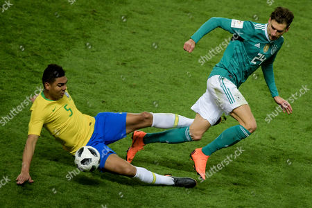 9879bb2a5aa3 Brazil s Casimiro (L) in action against Germany s Leon Goretzka during an  international friendly soccer