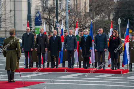 (L-R) Croatian Deputy Minister of Defence Petar Mihatov, Poland's Deputy Minister of National Defence Tomasz Szatkowski, Peter Gajdos of Slovakian, Istvan Simicsko of Hungary, Karla Slechtova of Czech Republic, Mario Kunasek of Austria and Andreja Katic of Slovenia attend a wreath-laying ceremony at Heroes Square in Budapest, Hungary, 27 March 2018, ahead of the meeting of the Central European Defence Cooperation (CEDC) on 28 March.