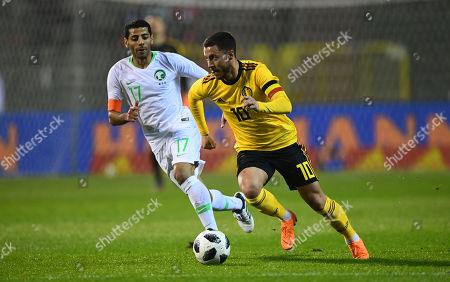 Eden Hazard of Belgium gets away from Taisir Al-Jassim of Saudi Arabia