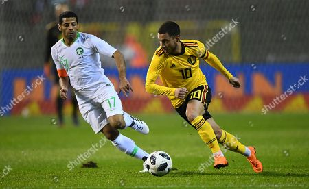 Eden Hazard of Belgium chased by Taisir Al-Jassim of Saudi Arabia
