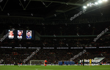 England and Italy players respect a minutes applause ahead of kick off in memory of Davide Astori, Jimmy Armfield and Cyrille Regis