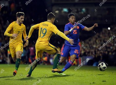 Colombia's Johan Mojica, right, duels for the ball with Australia's Josh Risdon during a friendly soccer match between Colombia and Australia at Craven Cottage stadium in London