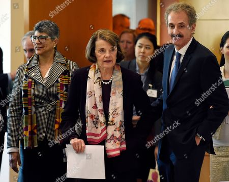 Dianne Feinstein, Mike Feuer. California Sen. Dianne Feinstein, center, and Los Angeles City Attorney Mike Feuer, right, exit a a roundtable discussion on gun safety with gun violence survivors and family members, activists and medical personnel at the UCLA Medical Center, in Los Angeles