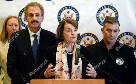 Dianne Feinstein, Mike Feuer, Paul Wilson. California Sen. Dianne Feinstein, center, is flanked by Los Angeles City Attorney Mike Feuer, left, and Paul Wilson, right, whose wife Christi was one of the eight victims of a mass shooting at a Seal Beach, Calif., beauty salon in 2011, as she addresses reporters following a roundtable discussion on gun safety at the UCLA Medical Center, in Los Angeles