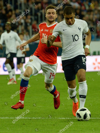 Players (from left to right) Russian national team Vladimir Granat and French national team Kilian Mbappe