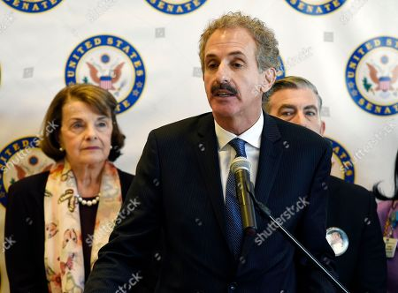 Dianne Feinstein, Mike Feuer. Los Angeles City Attorney Mike Feuer addresses reporters following a roundtable discussion on gun safety at the UCLA Medical Center, in Los Angeles. At left is California Sen. Dianne Feinstein
