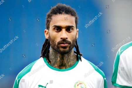 Stock Picture of Senegal's Armand Traore listens to national anthem prior to a friendly soccer match between Senegal and Bosnia and Herzegovina at the Oceane stadium in Le Havre, northern France