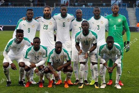 The Senegal national soccer team pose before a friendly soccer match between Senegal and Bosnia and Herzegovina at the Oceane stadium in Le Havre, northern France, . First row, from left, Papy Djilobodji, Henri Saivet, Youssou Sabaly, Sadio Mane, Cheikh Tidiane Ndoye. Second row, from left, Mame Biram Diouf, Armand Traore, Salif Sane, Moussa Sow, AKalidou Koulibaly, Abdoulaye Diallo