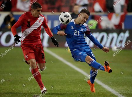 Iceland midfielder Arnor Traustason, right, tries to keep the ball in bounds as Peru's Aldo Corzo defends during the second half of an international friendly soccer match, in Harrison, N.J. Peru won 3-1