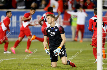 Frederik Schram, Jefferson Farfan. Iceland goalkeeper Frederik Schram reacts after giving up a goal to Peru forward Jefferson Farfan during the second half of an international friendly soccer match, in Harrison, N.J. Peru won 3-1